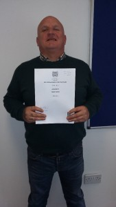 Tommy with his SVQ 2 Social Services and Health Care qualification